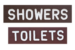 duschen undertecknar toaletten Royaltyfri Bild