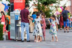 Dushanbe residents on the streets of the city. DUSHANBE, TAJIKISTAN - CIRCA JUNE 2017: Dushanbe residents on the streets of the city circa June 2017 in Dushanbe stock image
