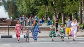 Dushanbe residents on the streets of the city. DUSHANBE, TAJIKISTAN - CIRCA JUNE 2017: Dushanbe residents on the streets of the city circa June 2017 in Dushanbe stock photos