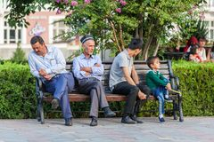 Dushanbe residents on the streets of the city. DUSHANBE, TAJIKISTAN - CIRCA JUNE 2017: Dushanbe residents on the streets of the city circa June 2017 in Dushanbe stock photo