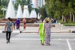 Dushanbe residents on the streets of the city. DUSHANBE, TAJIKISTAN - CIRCA JUNE 2017: Dushanbe residents on the streets of the city circa June 2017 in Dushanbe stock images