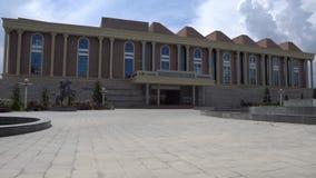 Dushanbe Tajikistan National Museum 118. Dushanbe Tajikistan National Museum at Flagpole Park near Ismoil Somoni Avenue on a Sunny Blue Sky Day stock video