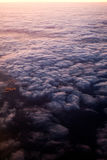 Flying over clouds. The night on the ground and sunshine over the clouds. Flying above South France Royalty Free Stock Photography