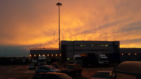 Dusk at the airport. Red sky at night airline building Royalty Free Stock Photography