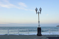 Dusk in Asturias 3. A beautiful simple composition with street light, sea and sky Stock Images
