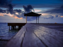 Dusk on an atoll, Maldives. Small jetty on an atoll in Maldives Stock Photography