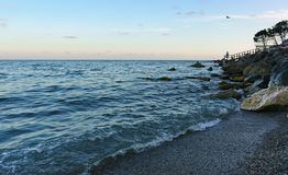 Dusk on the beautiful beach of Zelenyy Mys in Alupka. Calm evening sea. In Crimea royalty free stock image