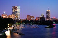 Dusk on Boston. The lights of Boston reflect in the Charles River at dusk stock photo