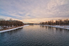 Dusk on the Bow River. In winter with pink tones in the sky Stock Images