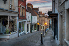 Dusk at Catherine Hill in Frome. Dusk on Catherine Hill a cobbled street of historic buildings at Frome in Somerset Stock Photography