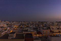 Dusk cityscape in Olhao, Algarve fishing village view of ancient neighbourhood of Barreta. And its traditional cubist architecture. Portugal Stock Photos