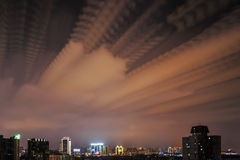 Dusk cloud sky over urban city stock images