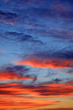 Dusk clouds. Colors of the dusk clouds. Blue and orange Stock Image