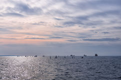Dusk colors on a cloudy sky over the sea in Thessaloniki, Greece Stock Photos