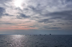 Dusk colors on a cloudy sky over the sea in Thessaloniki, Greece Stock Images
