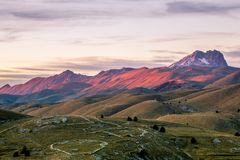 Colorful Monte Prena. The dusk colors falling on the mountains before Monte Prena in the Apennine mountain range Stock Image