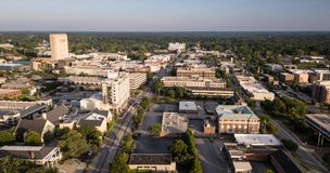 Dusk Comes to Main Street in Spartanburg South Carolina. The roads and buildings are seen from this aerial view of Spartanburg SC royalty free stock photo