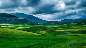 Dusk green mountains at spring, Castelluccio, Italy stock video footage