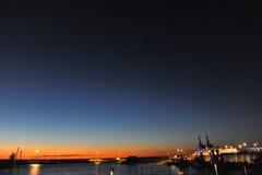 Dusk on the harbor Stock Photos