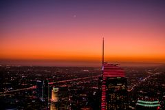 At dusk, the highest point in Los Angeles has a beautiful sunset with stars and the moon royalty free stock image