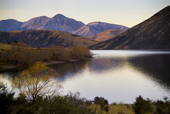 Dusk Lake. Highland lake with last patches of light giving pastel colours on nearby hills stock images