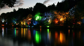 Dusk lake. Colourful artificial lights over an urban lake. Dusk in New Plymouth, New Zealand stock images