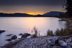 Dusk on lake of Aix les Bains. Dusk on a lake surrounded by mountains Royalty Free Stock Images
