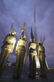 Dusk light behind bronze Honor Guard and three soaring spires of the Air Force Memorial, One Air Force Memorial Drive, Arlington,  Stock Photos