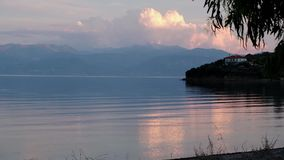 Dusk Light on Gulf of Corinth Bay, Greece. Gently rippled sea water in a Gulf of Corinth bay, Ormos Lemonias, with dusk light, blue Peloponnese mountains and stock video footage