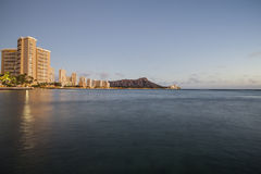 Dusk light on Waikiki Bay in Honolulu Hawaii Stock Photography