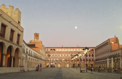 Dusk moon in High Square, Badajoz. BADAJOZ, SPAIN - AUGUST 27 2015:  Dusk moon in High Square, Plaza Alta on Badajoz, 27 august 2015 Royalty Free Stock Photo