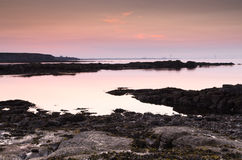 Dusk on Northumberland coastline Stock Image
