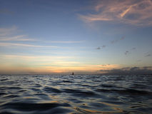 Dusk on the ocean waters of Waikiki Stock Photography
