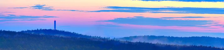 Dusk over hilly forest Royalty Free Stock Photos