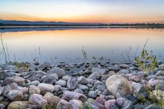 Dusk over a lake in Colorado foothills Stock Images