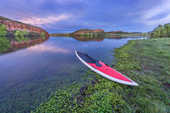 Dusk over lake with paddleboard Royalty Free Stock Photo