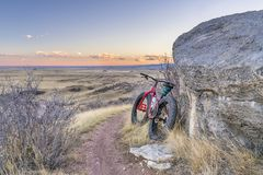 Dusk over prairie with fat bike Royalty Free Stock Images