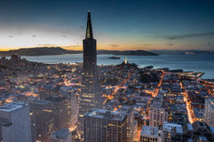 San Francisco Financial District and Bay, Dusk. Aerial view of San Francisco from high-rise building in the heart of the Financial District Stock Photos