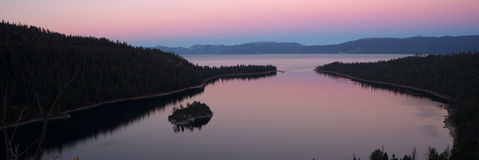 Dusk Protected Cove Emerald Bay Fannette Island Lake Tahoe. The sun has set leaving purple mutted hues on Emerald Bay royalty free stock photography