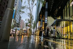 Dusk rain at Tokyo's luxury shopping district Ginza. A rainy night shopping in the Ginza district, Tokyo Stock Photography