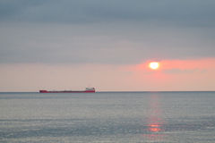 Dusk red light above the sea, ship silhouette Royalty Free Stock Photo