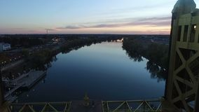 Tower bridge vertical lift crossing Sacramento River Sunset Aerial stock video footage