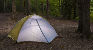 Dusk remote campsite. Nylon tent in a campsite as darkness is falling stock photo