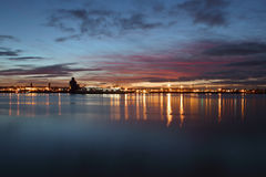 Dusk on the River Mersey. Sunset on the river mersey and Birkenhead skyline. Taken on Liverpools pierhead Stock Image