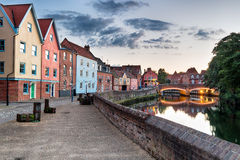 Dusk on the River Yare. Colorful houses at dusk on the river Yare as it flows through the city of Norisch in Norfolk Stock Photography