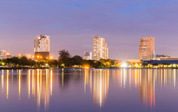 Dusk Scene Of Lake and City at the Benjakiti Park Royalty Free Stock Images