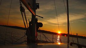 Dusk at sea, crew working on sailing yacht, coming home. Stock footage stock footage