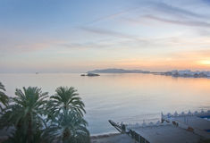 Dusk seaside view. IBIZA, BALEARIC ISLANDS, SPAIN - DECEMBER 16, 2015: Figuereta bay at sunset on December 16, 2015 in Ibiza, Balearic islands, Spain Dusk Royalty Free Stock Images