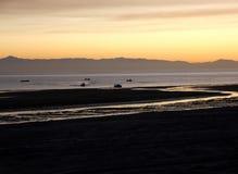 Dusk settling over the Sea of Cortez, El Golfo, Mexico. Sun slowly setting at el golfo de santa clara, Sonora, Mexico. Brilliant Orange, yellow, blues, sea royalty free stock photos