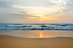 Meditation in front of ocean waves and the low sun Royalty Free Stock Images